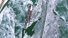 Transport ships trapped in the frozen Danube river