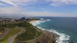 Newcastle, and old fort, Hang Gliders and the Ocean - what more could you want?