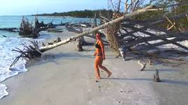 GIRL DANCES ON BEACH WITH DRONE